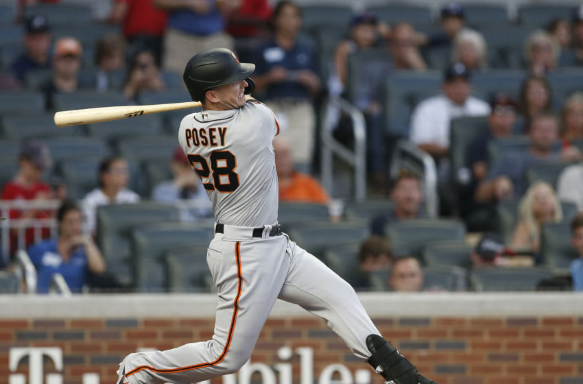 ATLANTA, GEORGIA - SEPTEMBER 21: Catcher Buster Posey #28 of the San Francisco Giants bats during the game against the Atlanta Braves on September 21, 2019 in Atlanta, Georgia. (Photo by Mike Zarrilli/Getty Images)