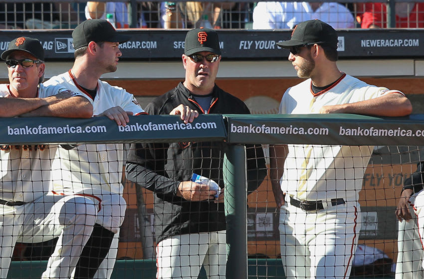 SAN FRANCISCO, CA - SEPTEMBER 03: Madison Bumgarner #40 of the San Francisco Giants and Brandon Belt #9 of the San Francisco Giants talk to Will Clark during a game against the Arizona Diamondbacks at AT&T Park on September 3, 2012 in San Francisco, California. (Photo by Tony Medina/Getty Images)