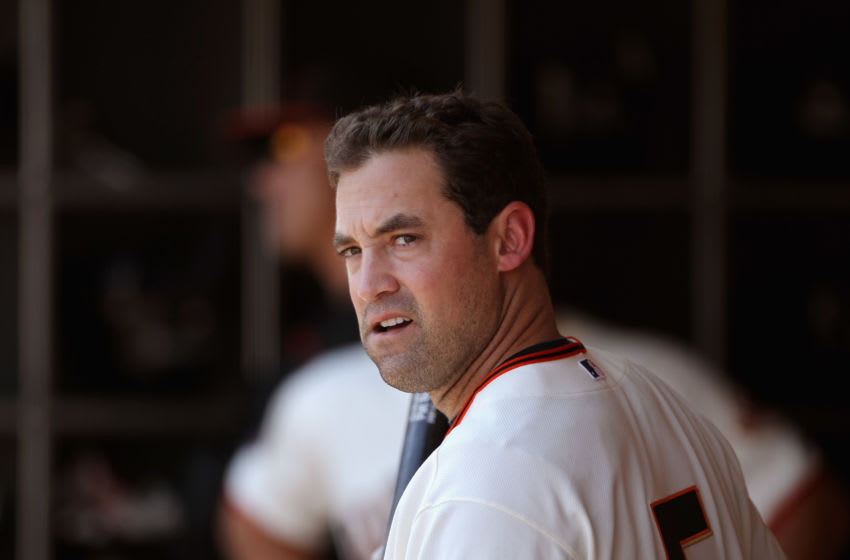 Pat Burrell of the SF Giants stands in the dugout. (Photo by Ezra Shaw/Getty Images)