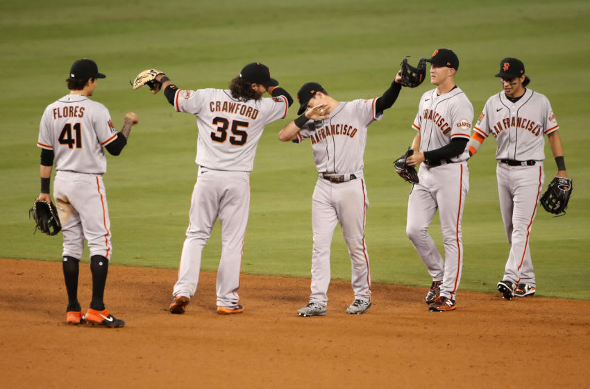 The San Francisco Giants celebrate their win over the Los Angeles Dodgers. (Photo by Katelyn Mulcahy/Getty Images)