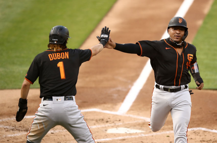 SF Giants utility-man Mauricio Dubon and catcher Chadwick Tromp. (Photo by Ezra Shaw/Getty Images)