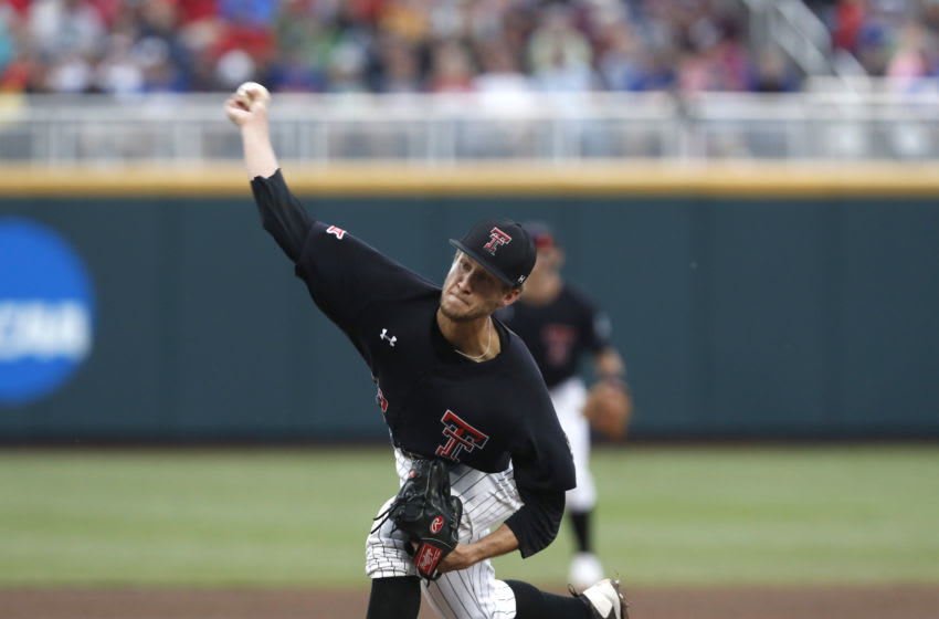 Jun 21, 2018; Omaha, NE, USA; Texas Tech Red Raiders pitcher Caleb Kilian (32) throws against the Florida Gators in the first inning in the College World Series at TD Ameritrade Park. Mandatory Credit: Bruce Thorson-USA TODAY Sports