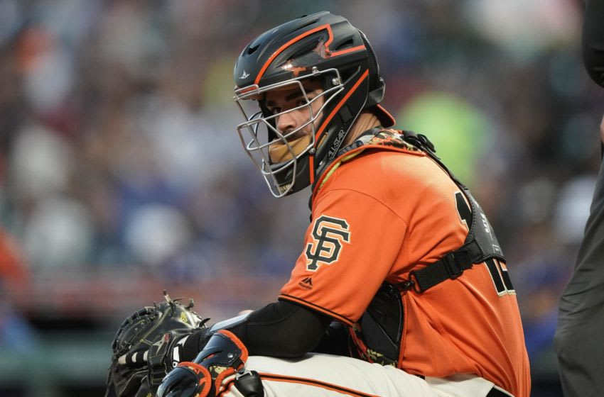 Jun 7, 2019; San Francisco, CA, USA; SF Giants catcher Aramis Garcia (16) looks at the dugout in the game against the Los Angeles Dodgers during the third inning at Oracle Park. Mandatory Credit: Stan Szeto-USA TODAY Sports