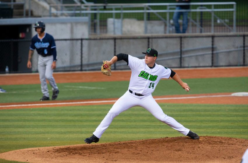 Eugene Emeralds pitcher Seth Corry, right, throws against Hillsboro with a player in third during the second inning at PK Park in Eugene.