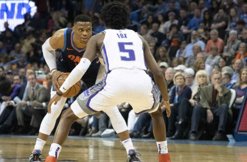 OKLAHOMA CITY, OK - OCTOBER 21: Russell Westbrook #0 of the Oklahoma City Thunder drives around De'Aaron Fox #5 of the Sacramento Kings during the first half of a NBA game at the Chesapeake Energy Arena on October 21, 2018 in Oklahoma City, Oklahoma. NOTE TO USER: User expressly acknowledges and agrees that, by downloading and or using this photograph, User is consenting to the terms and conditions of the Getty Images License Agreement. (Photo by J Pat Carter/Getty Images)