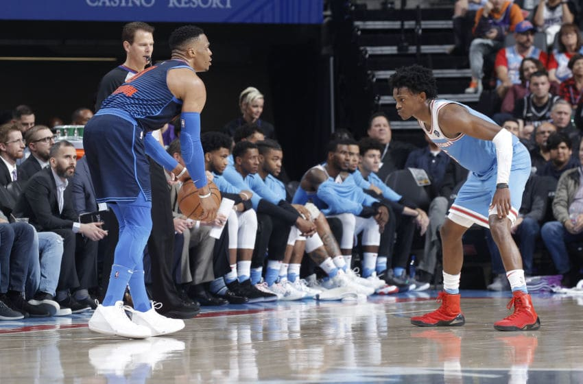 SACRAMENTO, CA - NOVEMBER 19: Russell Westbrook #0 of the Oklahoma City Thunder handles the ball against De'Aaron Fox #5 of the Sacramento Kings on November 19, 2018 at Golden 1 Center in Sacramento, California. NOTE TO USER: User expressly acknowledges and agrees that, by downloading and or using this photograph, User is consenting to the terms and conditions of the Getty Images Agreement. Mandatory Copyright Notice: Copyright 2018 NBAE (Photo by Rocky Widner/NBAE via Getty Images)