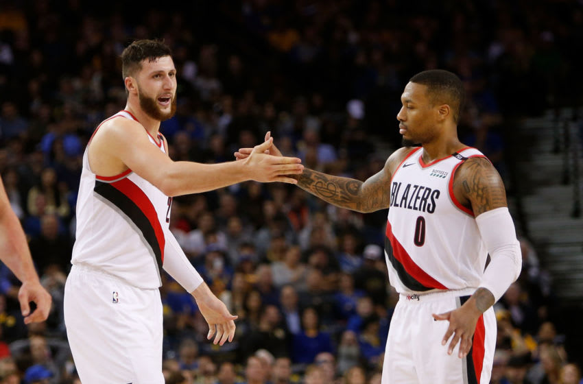OAKLAND, CA - NOVEMBER 23: Jusuf Nurkic #27 celebrates with Damian Lillard #0 of the Portland Trail Blazers during the game against the Golden State Warriors at ORACLE Arena on November 23, 2018 in Oakland, California. NOTE TO USER: User expressly acknowledges and agrees that, by downloading and or using this photograph, User is consenting to the terms and conditions of the Getty Images License Agreement. (Photo by Lachlan Cunningham/Getty Images)