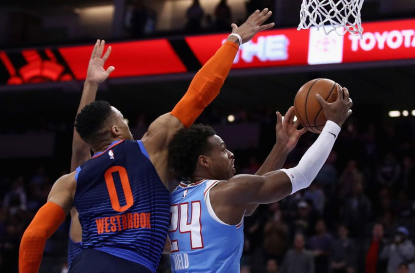 SACRAMENTO, CA - DECEMBER 19: Buddy Hield #24 of the Sacramento Kings goes up for a shot on Russell Westbrook #0 of the Oklahoma City Thunder at Golden 1 Center on December 19, 2018 in Sacramento, California. NOTE TO USER: User expressly acknowledges and agrees that, by downloading and or using this photograph, User is consenting to the terms and conditions of the Getty Images License Agreement. (Photo by Ezra Shaw/Getty Images)
