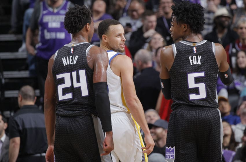 SACRAMENTO, CA - JANUARY 5: Stephen Curry #30 of the Golden State Warriors faces off against De'Aaron Fox #5 and Buddy Hield #24 of the Sacramento Kings on January 5, 2019 at Golden 1 Center in Sacramento, California. NOTE TO USER: User expressly acknowledges and agrees that, by downloading and or using this photograph, User is consenting to the terms and conditions of the Getty Images Agreement. Mandatory Copyright Notice: Copyright 2019 NBAE (Photo by Rocky Widner/NBAE via Getty Images)