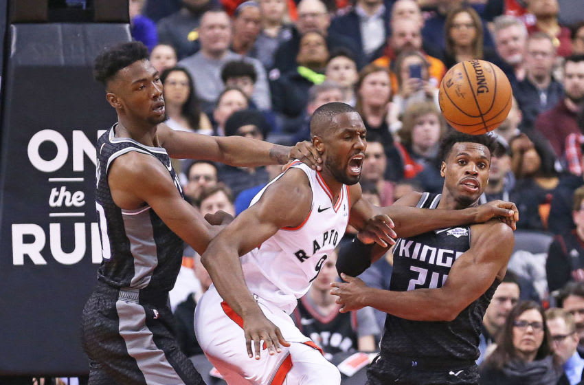 TORONTO, ON - JANUARY 22: Serge Ibaka #9 of the Toronto Raptors battles between Harry Giles III #20 and Buddy Hield #24 of the Sacramento Kings in an NBA game at Scotiabank Arena on January 22, 2019 in Toronto, Ontario, Canada. The Raptors defeated the Kings 120-105. NOTE TO USER: user expressly acknowledges and agrees by downloading and/or using this Photograph, user is consenting to the terms and conditions of the Getty Images Licence Agreement. ( Photo by Claus Andersen/Getty Images)