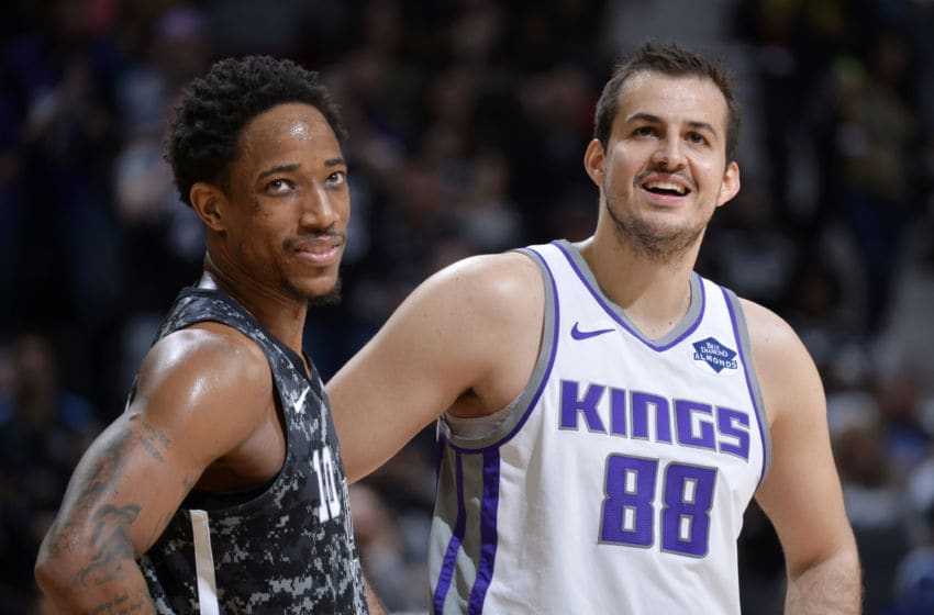 SAN ANTONIO, TX - MARCH 31: DeMar DeRozan #10 of the San Antonio Spurs and Nemanja Bjelica #88 of the Sacramento Kings look on during the game on March 31, 2019 at the AT&T Center in San Antonio, Texas. NOTE TO USER: User expressly acknowledges and agrees that, by downloading and or using this photograph, user is consenting to the terms and conditions of the Getty Images License Agreement. Mandatory Copyright Notice: Copyright 2019 NBAE (Photos by Mark Sobhani/NBAE via Getty Images)