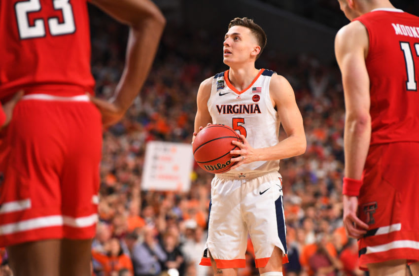 MINNEAPOLIS, MINNESOTA - APRIL 08: Kyle Guy #5 of the Virginia Cavaliers shoots a free throw against the Texas Tech Red Raiders during overtime of the 2019 NCAA men's Final Four National Championship game at U.S. Bank Stadium on April 08, 2019 in Minneapolis, Minnesota. (Photo by Jamie Schwaberow/NCAA Photos via Getty Images)