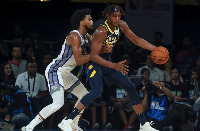 Indiana Pacers player Myles Turner (R) and Sacramento Kings player Marvin Bagley fight for the ball during the first pre-season NBA basketball game between Sacramento Kings and Indiana Pacers at the NSCI Dome in Mumbai on October 4, 2019. (Photo by PUNIT PARANJPE / AFP) (Photo by PUNIT PARANJPE/AFP via Getty Images)