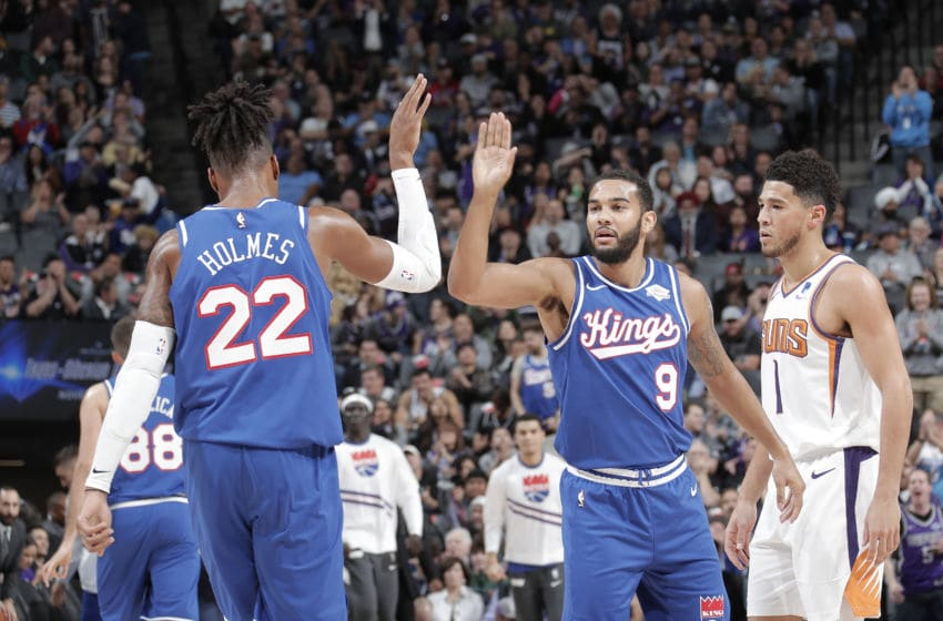 SACRAMENTO, CA - NOVEMBER 19: Richaun Holmes #22, and Cory Joseph #9 of the Sacramento Kings hi-five each other against the Phoenix Suns on November 19, 2019 at Golden 1 Center in Sacramento, California. NOTE TO USER: User expressly acknowledges and agrees that, by downloading and or using this Photograph, user is consenting to the terms and conditions of the Getty Images License Agreement. Mandatory Copyright Notice: Copyright 2019 NBAE (Photo by Rocky Widner/NBAE via Getty Images)