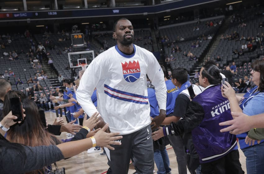 SACRAMENTO, CA - NOVEMBER 19: Dewayne Dedmon #13 of the Sacramento Kings greets fans while running onto the court against the Phoenix Suns on November 19, 2019 at Golden 1 Center in Sacramento, California. NOTE TO USER: User expressly acknowledges and agrees that, by downloading and or using this photograph, User is consenting to the terms and conditions of the Getty Images Agreement. Mandatory Copyright Notice: Copyright 2019 NBAE (Photo by Rocky Widner/NBAE via Getty Images)