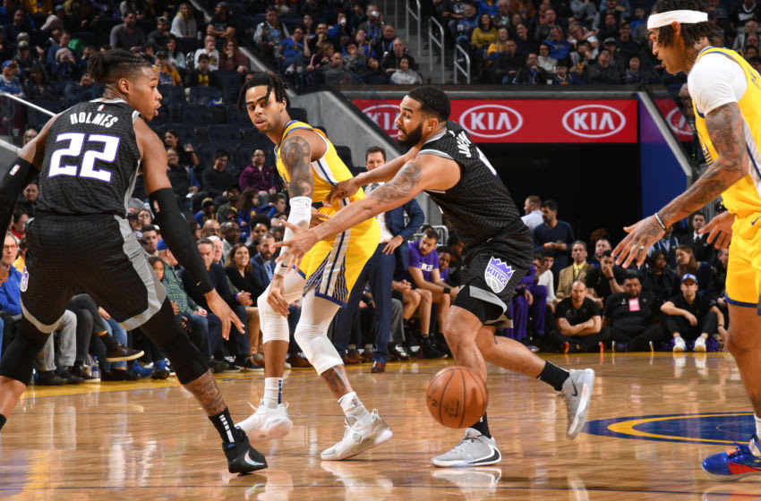 SAN FRANCISCO, CA - DECEMBER 15: D'Angelo Russell #0 of the Golden State Warriors passes the ball against the Sacramento Kings on December 15, 2019 at Chase Center in San Francisco, California. NOTE TO USER: User expressly acknowledges and agrees that, by downloading and or using this photograph, user is consenting to the terms and conditions of Getty Images License Agreement. Mandatory Copyright Notice: Copyright 2019 NBAE (Photo by Noah Graham/NBAE via Getty Images)