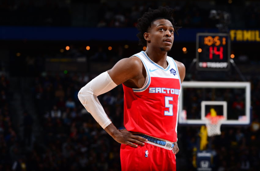 DENVER, CO - DECEMBER 29: De'Aaron Fox #5 of the Sacramento Kings looks on during the game against the Denver Nuggets on December 29, 2019 at the Pepsi Center in Denver, Colorado. NOTE TO USER: User expressly acknowledges and agrees that, by downloading and/or using this Photograph, user is consenting to the terms and conditions of the Getty Images License Agreement. Mandatory Copyright Notice: Copyright 2019 NBAE (Photo by Bart Young/NBAE via Getty Images)