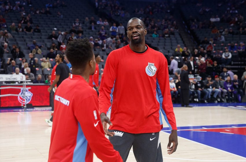 SACRAMENTO, CALIFORNIA - DECEMBER 11: Dewayne Dedmon #13 of the Sacramento Kings talks to teammate Yogi Ferrell #3 before the game against the Oklahoma City Thunder at Golden 1 Center on December 11, 2019 in Sacramento, California. NOTE TO USER: User expressly acknowledges and agrees that, by downloading and/or using this photograph, user is consenting to the terms and conditions of the Getty Images License Agreement. NOTE TO USER: User expressly acknowledges and agrees that, by downloading and/or using this photograph, user is consenting to the terms and conditions of the Getty Images License Agreement. (Photo by Lachlan Cunningham/Getty Images)