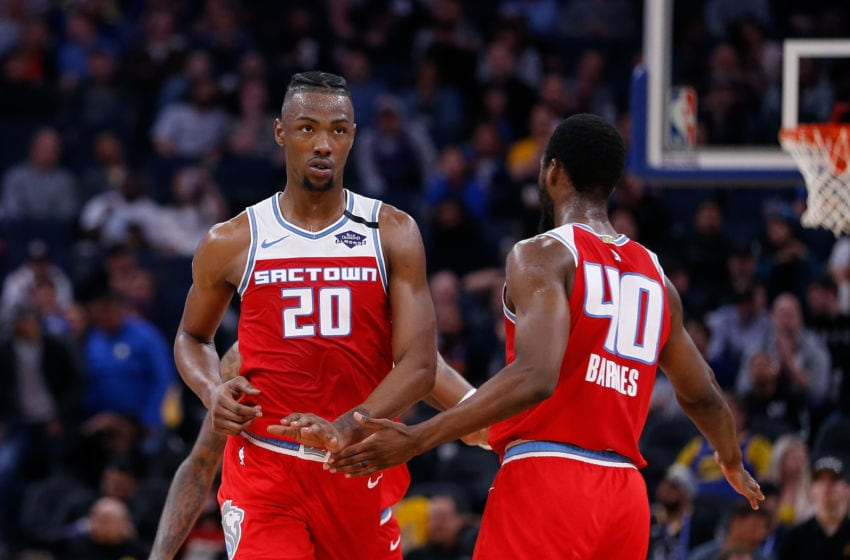 SAN FRANCISCO, CALIFORNIA - FEBRUARY 25: Harry Giles III #20 of the Sacramento Kings celebrates a basket with Harrison Barnes #40 in the second half against the Golden State Warriors at Chase Center on February 25, 2020 in San Francisco, California. NOTE TO USER: User expressly acknowledges and agrees that, by downloading and/or using this photograph, user is consenting to the terms and conditions of the Getty Images License Agreement. (Photo by Lachlan Cunningham/Getty Images)