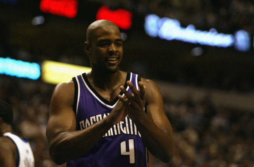 DALLAS - MAY 8: Chris Webber #4 of the Sacramento Kings claps in Game two of the Western Conference Semifinals against the Dallas Mavericks during the 2003 NBA Playoffs at American Airlines Center on May 8, 2003 in Dallas, Texas. The Mavericks won 132-110. NOTE TO USER: User expressly acknowledges and agrees that, by downloading and/or using this Photograph, User is consenting to the terms and conditions of the Getty Images License Agreement Mandatory Copyright Notice: Copyright 2003 NBAE (Photo by Ronald Martinez/Getty Images)