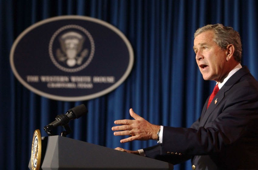 CRAWFORD, TX - DECEMBER 29: (AFP OUT) U.S. President George W. Bush answers questions during a news conference at his ranch December 29, 2004 near Crawford, Texas. President Bush spoke on a large number of issues including the aid for the Tsunami victims, Iraq elections as well as flooding on the West Coast. (Photo by Rod Aydelotte-Pool/Getty Images)