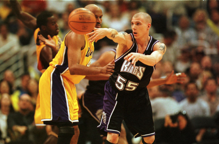23 Apr 2000: Guard Jason Williams #55 of the Sacramento Kings passes around guard Ron Harper #4 of the Los Angeles Lakers during game one of the NBA Playoffs at Staples Center in Los Angeles, California. The Lakers defeated the Kings 117-107.
