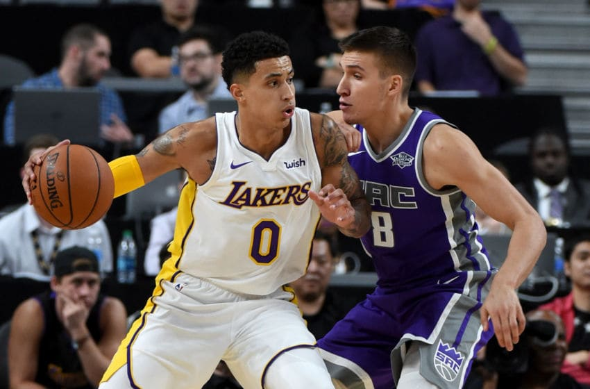 LAS VEGAS, NV - OCTOBER 08: Kyle Kuzma #0 of the Los Angeles Lakers drives against Bogdan Bogdanovic #8 of the Sacramento Kings during their preseason game at T-Mobile Arena on October 8, 2017 in Las Vegas, Nevada. Los Angeles won 75-69. NOTE TO USER: User expressly acknowledges and agrees that, by downloading and or using this photograph, User is consenting to the terms and conditions of the Getty Images License Agreement. (Photo by Ethan Miller/Getty Images)