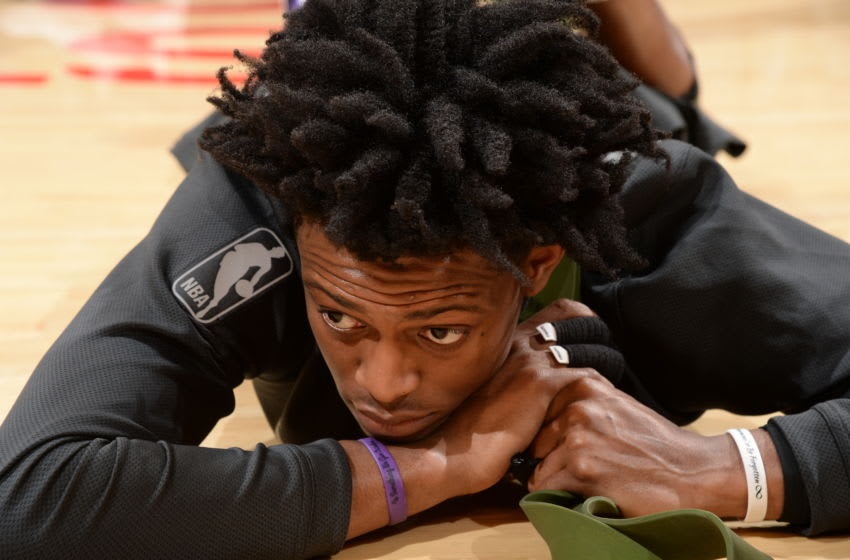 LOS ANGELES, CA - APRIL 1: De'Aaron Fox #5 of the Sacramento Kings is stretched before the game against the Los Angeles Lakers on April 1, 2018 at STAPLES Center in Los Angeles, California. NOTE TO USER: User expressly acknowledges and agrees that, by downloading and/or using this Photograph, user is consenting to the terms and conditions of the Getty Images License Agreement. Mandatory Copyright Notice: Copyright 2018 NBAE (Photo by Andrew Bernstein/NBAE via Getty Images)