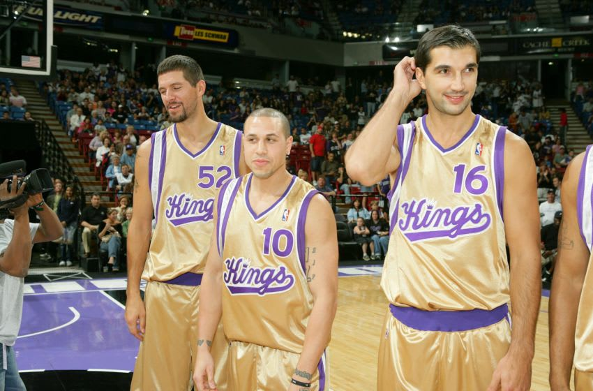 SACRAMENTO, CA - OCTOBER 8: (L-R) Brad Miller #52, Mike Bibby #10 and Peja Stojakovic #16 share a laugh as the Sacramento Kings host Fandemonium at ARCO Arena on October 8, 2005 in Sacramento, California. NOTE TO USER: User expressly acknowledges and agrees that, by downloading and/or using this Photograph, User is consenting to the terms and conditions of the Getty Images License Agreement. Mandatory Copyright Notice: Copyright 2005 NBAE (Photo by Rocky Widner/NBAE via Getty Images)