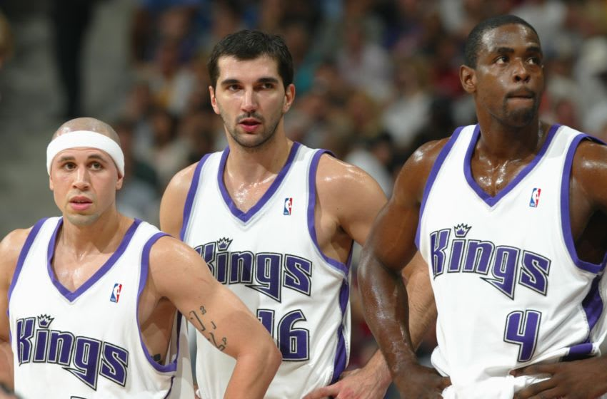 SACRAMENTO, CA - MAY 16: Chris Webber #4, Predrag Stojakovic #16, and Mike Bibby #10 of the Sacramento Kings are shown during a break in the action against the Minnesota Timberwolves in Game 6 of Round 2 of the 2004 NBA Western Conference Playoffs May 16, 2004, at Arco Arena in Sacramento, California. NOTE TO USER: User expressly aknowledges and agrees that, by downloading and/or using this Photograph, User is consenting to the terms and conditions of the Getty Images License Agreement. Mandatory Copyright Notice: Copyright 2004 NBAE (Photo by Rocky Widner/NBAE via Getty Images)