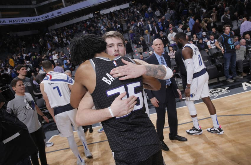SACRAMENTO, CA - JANUARY 15: Luka Doncic #77 of the Dallas Mavericks greets Marvin Bagley III #35 of the Sacramento Kings on January 15, 2020 at Golden 1 Center in Sacramento, California. NOTE TO USER: User expressly acknowledges and agrees that, by downloading and or using this photograph, User is consenting to the terms and conditions of the Getty Images Agreement. Mandatory Copyright Notice: Copyright 2020 NBAE (Photo by Rocky Widner/NBAE via Getty Images)