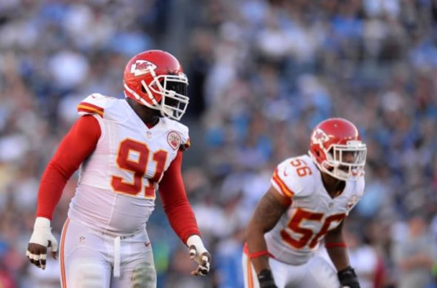 Nov 22, 2015; San Diego, CA, USA; Kansas City Chiefs outside linebacker Tamba Hali (91) and inside linebacker Derrick Johnson (56) in the field during the third quarter against the San Diego Chargers at Qualcomm Stadium. Mandatory Credit: Jake Roth-USA TODAY Sports