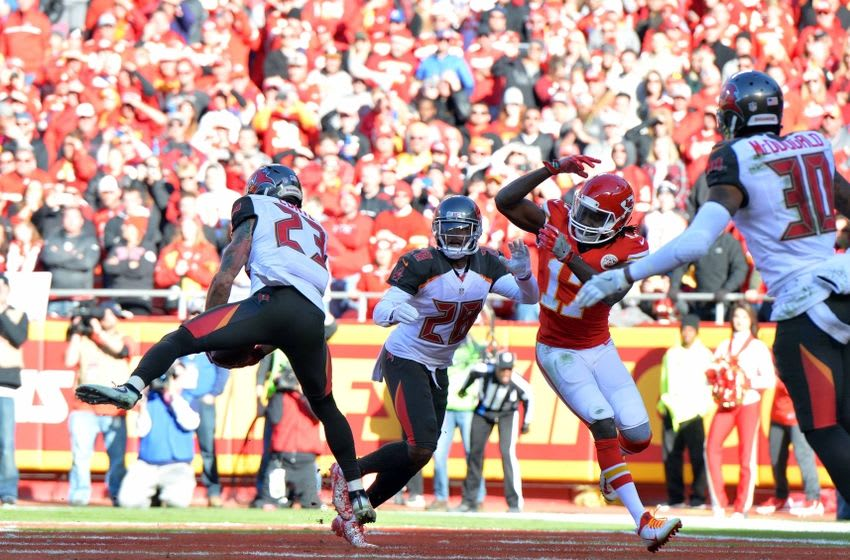 Nov 20, 2016; Kansas City, MO, USA; Tampa Bay Buccaneers strong safety Chris Conte (23) intercepts a pass intended for Kansas City Chiefs wide receiver Chris Conley (17) during the second half at Arrowhead Stadium. Tampa Bay won 19-17. Mandatory Credit: Denny Medley-USA TODAY Sports