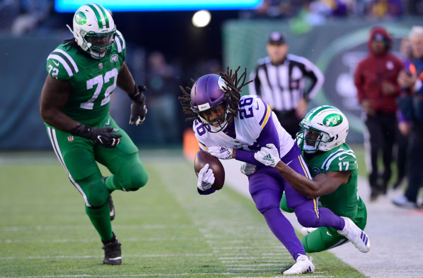 EAST RUTHERFORD, NJ - OCTOBER 21: Trae Waynes #26 of the Minnesota Vikings is tackled by Charone Peake #17 of the New York Jets after intercepting the ball during the fourth quarter at MetLife Stadium on October 21, 2018 in East Rutherford, New Jersey. The Vikings defeated the Jets 37-17. (Photo by Steven Ryan/Getty Images)