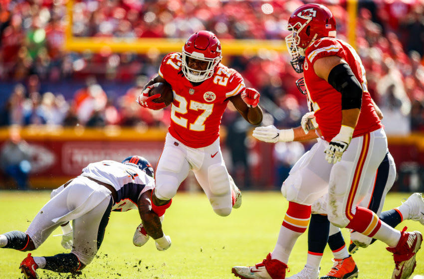 KANSAS CITY, MO - OCTOBER 28: Kareem Hunt #27 of the Kansas City Chiefs attempts to leap over the tackle attempt Will Parks #34 of the Denver Broncos during the first half of the game at Arrowhead Stadium on October 28, 2018 in Kansas City, Missouri. (Photo by David Eulitt/Getty Images)