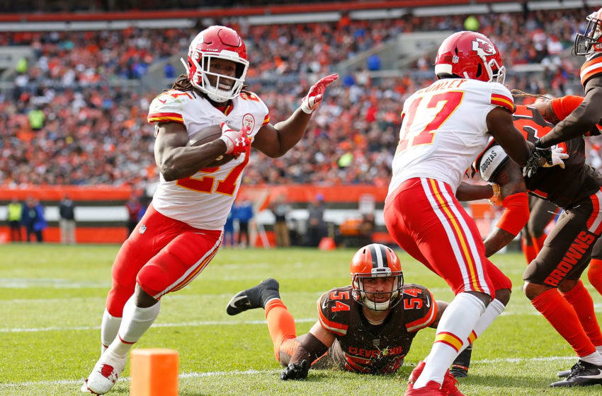 CLEVELAND, OH - NOVEMBER 04: Kareem Hunt #27 of the Kansas City Chiefs avoids a tackle by Tanner Vallejo #54 of the Cleveland Browns to score a touchdown during the third quarter at FirstEnergy Stadium on November 4, 2018 in Cleveland, Ohio. (Photo by Kirk Irwin/Getty Images)