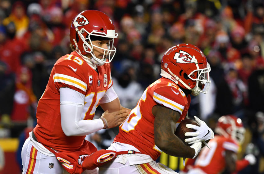 KANSAS CITY, MISSOURI - JANUARY 20: Patrick Mahomes #15 hands the ball off to Damien Williams #26 of the Kansas City Chiefs in the first half against the New England Patriots during the AFC Championship Game at Arrowhead Stadium on January 20, 2019 in Kansas City, Missouri. (Photo by Peter Aiken/Getty Images)