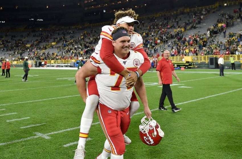 GREEN BAY, WISCONSIN - AUGUST 29: Patrick Mahomes #15 of the Kansas City Chiefs is escorted off the field on the back of Andrew Wylie #77 of the Kansas City Chiefs after the preseason game against the Green Bay Packers at Lambeau Field on August 29, 2019 in Green Bay, Wisconsin. (Photo by Quinn Harris/Getty Images)