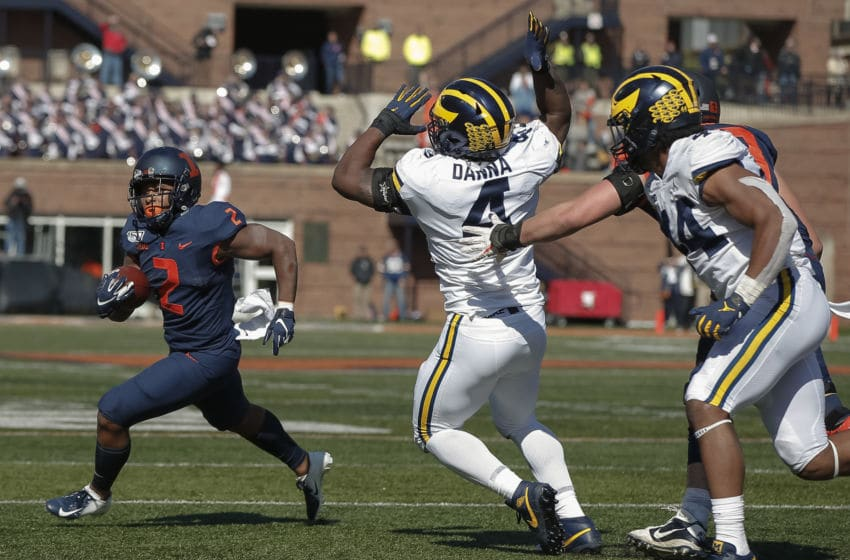 CHAMPAIGN, IL - OCTOBER 12: Reggie Corbin #2 of the Illinois Fighting Illini runs the ball as Michael Danna #4 of and Cameron McGrone #44 of the Michigan Wolverines pursues at Memorial Stadium on October 12, 2019 in Champaign, Illinois. (Photo by Michael Hickey/Getty Images)