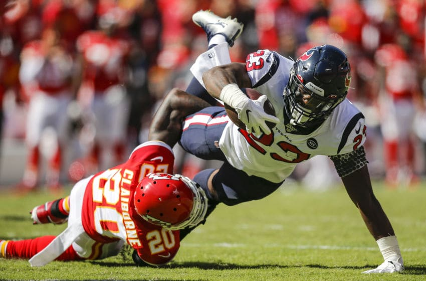 KANSAS CITY, MO - OCTOBER 13: Morris Claiborne #20 of the Kansas City Chiefs tackles Carlos Hyde #23 of the Houston Texans in the second quarter at Arrowhead Stadium on October 13, 2019 in Kansas City, Missouri. (Photo by David Eulitt/Getty Images)