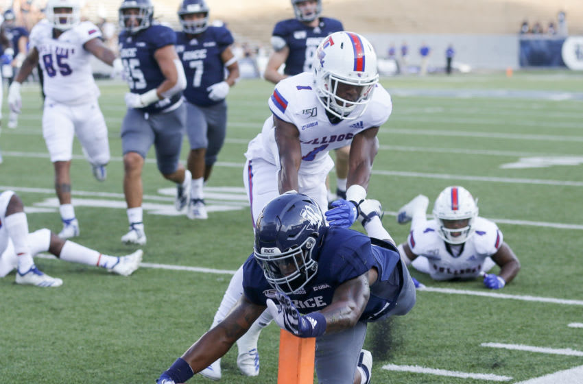 HOUSTON, TEXAS - SEPTEMBER 28: Aston Walter #1 of the Rice Owls rushes 16 yards for a touchdown as he beats L'Jarius Sneed #1 of the Louisiana Tech Bulldogs to the pylon during the first quarter at Rice Stadium on September 28, 2019 in Houston, Texas. (Photo by Bob Levey/Getty Images)