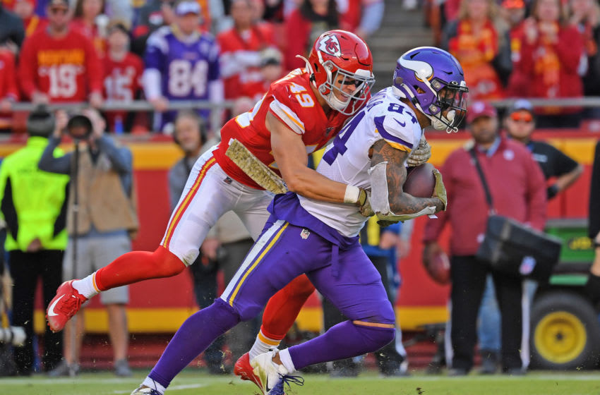 KANSAS CITY, MO - NOVEMBER 03: Defensive back Daniel Sorensen #49 of the Kansas City Chiefs tackles tight end Irv Smith #84 of the Minnesota Vikings for a loss during the second half at Arrowhead Stadium on November 3, 2019 in Kansas City, Missouri. (Photo by Peter Aiken/Getty Images)