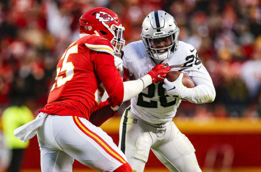 KANSAS CITY, MO - DECEMBER 01: Frank Clark #55 of the Kansas City Chiefs tackles Josh Jacobs #28 of the Oakland Raiders for a 7-yard loss in the second quarter at Arrowhead Stadium on December 1, 2019 in Kansas City, Missouri. (Photo by David Eulitt/Getty Images)