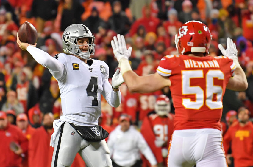 KANSAS CITY, MO - DECEMBER 01: Quarterback Derek Carr #4 of the Oakland Raiders passes a touchdown against defensive end Frank Clark #55 of the Kansas City Chiefs during the second half at Arrowhead Stadium on December 1, 2019 in Kansas City, Missouri. (Photo by Peter Aiken/Getty Images)