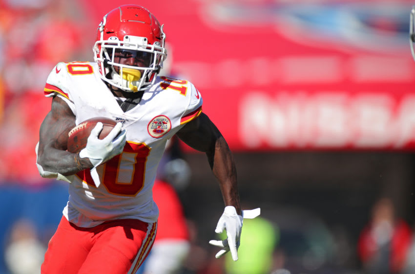 NASHVILLE, TENNESSEE - NOVEMBER 10: Wide receiver Tyreek Hill #10 of the Kansas City Chiefs rushes against the Tennessee Titans in the second quarter at Nissan Stadium on November 10, 2019 in Nashville, Tennessee. (Photo by Brett Carlsen/Getty Images)
