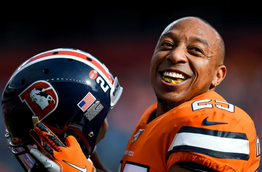 DENVER, CO - DECEMBER 22: Chris Harris #25 of the Denver Broncos smiles as he warms up before a game against the Detroit Lions at Empower Field at Mile High on December 22, 2019 in Denver, Colorado. (Photo by Dustin Bradford/Getty Images)