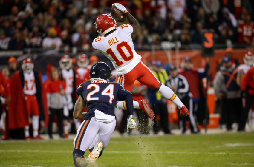 CHICAGO, ILLINOIS - DECEMBER 22: Wide receiver Tyreek Hill #10 of the Kansas City Chiefs makes a first-down catch against cornerback Buster Skrine #24 of the Chicago Bears in the first quarter of the game at Soldier Field on December 22, 2019 in Chicago, Illinois. (Photo by Jonathan Daniel/Getty Images)