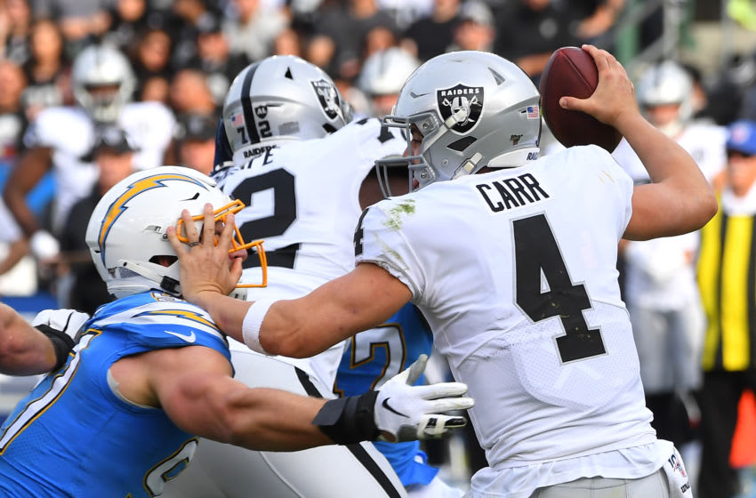 CARSON, CA - DECEMBER 22: Quarterback Derek Carr #4 of the Oakland Raiders is sacked by defensive end Joey Bosa #97 of the Los Angeles Chargers in the first half of the game at Dignity Health Sports Park on December 22, 2019 in Carson, California. (Photo by Jayne Kamin-Oncea/Getty Images)