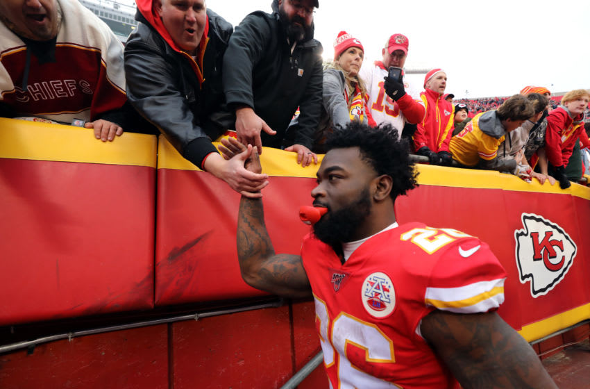 KANSAS CITY, MISSOURI - DECEMBER 29: Running back Damien Williams #26 of the Kansas City Chiefs celebrates with fans after the Chiefs defeated the Los Angeles Chargers 31-21 to win the game at Arrowhead Stadium on December 29, 2019 in Kansas City, Missouri. (Photo by Jamie Squire/Getty Images)