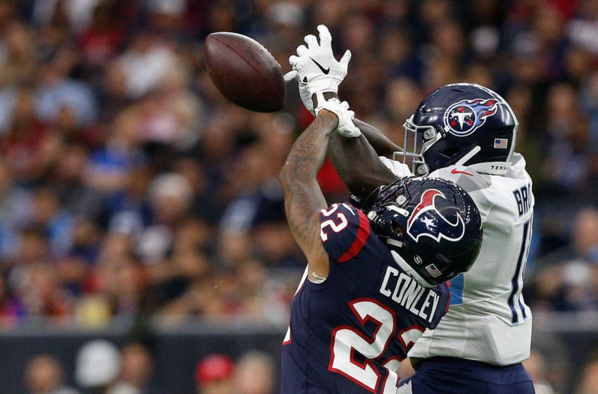HOUSTON, TEXAS - DECEMBER 29: Phillip Gaines #29 of the Houston Texans defends a pass intended for A.J. Brown #11 of the Tennessee Titans during the first half at NRG Stadium on December 29, 2019 in Houston, Texas. (Photo by Bob Levey/Getty Images)